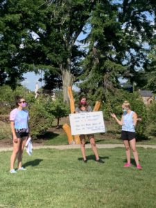 Three campers wear masks while participating in a game at Camp Therapyology. We offer summer programs for teens in West Bloomfield, MI. Contact us to learn more about how summer camp can help your teen thrive!