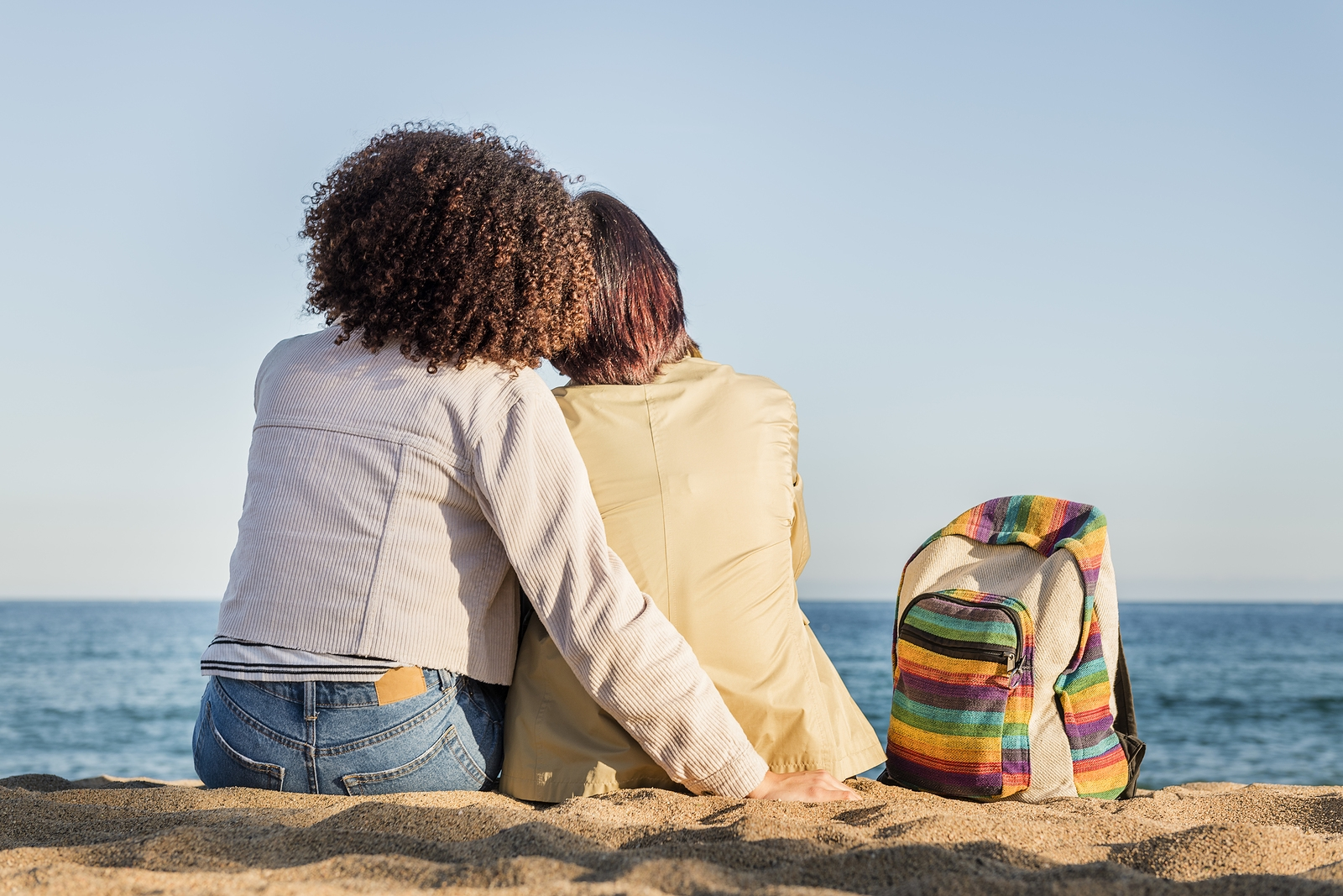 A lesbian couple sit and embrace as they look out over the sea. They have felt understood and safe at lgbt affirmative therapy in west bloomfield, mi. Therapyology offers lgbtq therapy in west bloomfield, mi. lgbt affirmative therapy in west bloomfield, mi, and more. Contact us today to get in touch with a lgbt ally in west bloomfield, mi.