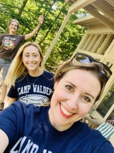 Three camp counselors smile for the camera as one waves. These are the counselors at Camp Walden & Camp Therapyology. Contact us to learn about summer programs for teens in West Bloomfield, MI. Summer camp can help your teen grow!
